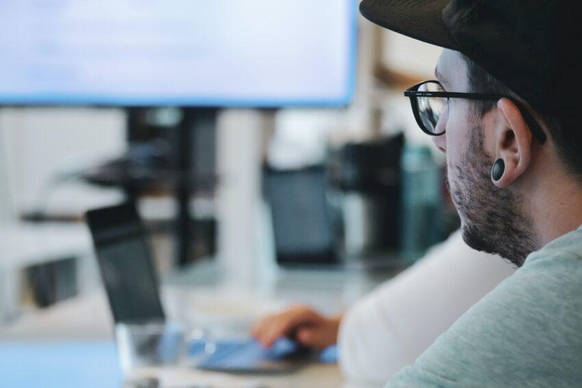 man in white sweater wearing black framed eyeglasses